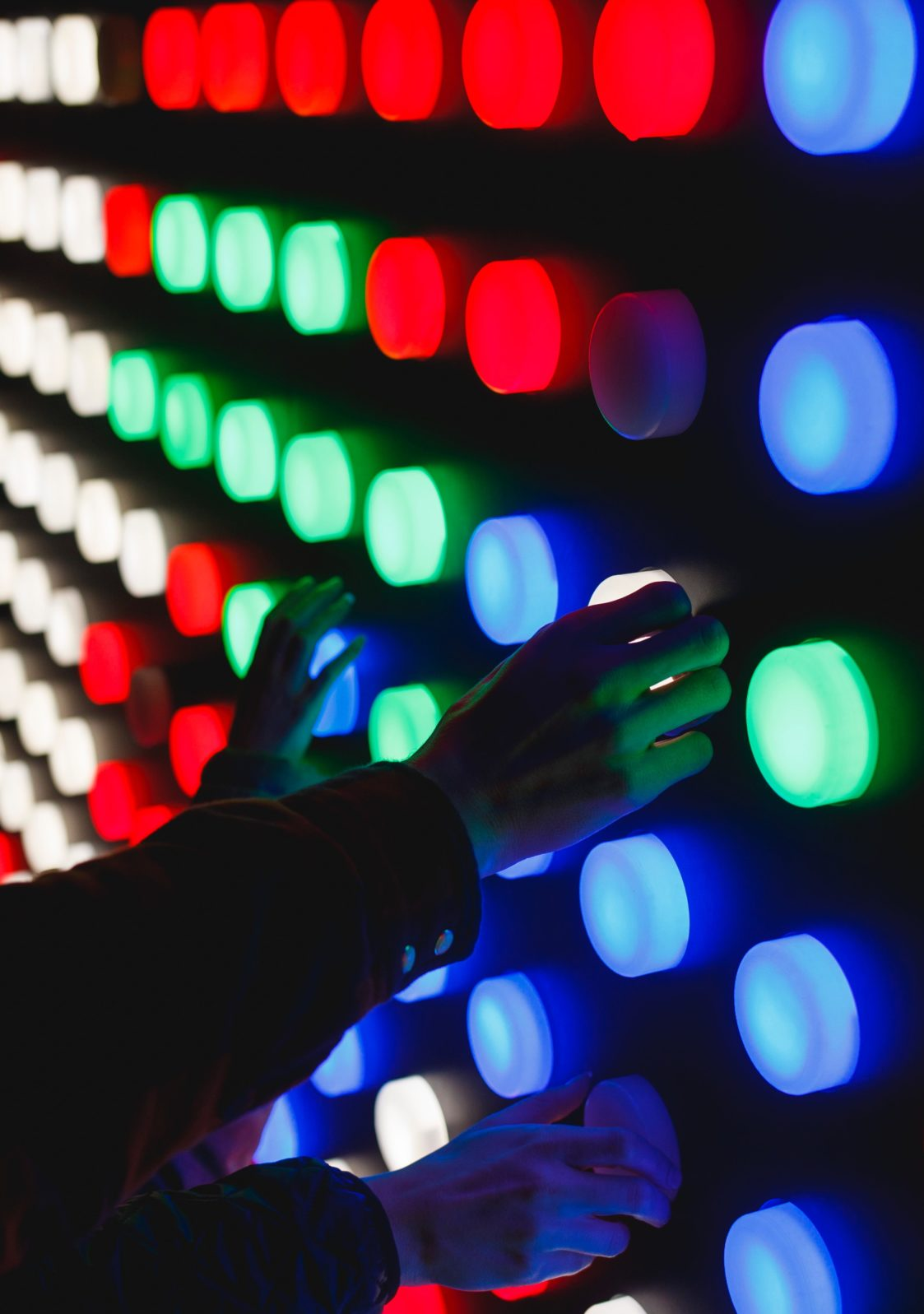 Hands selecting colored lights