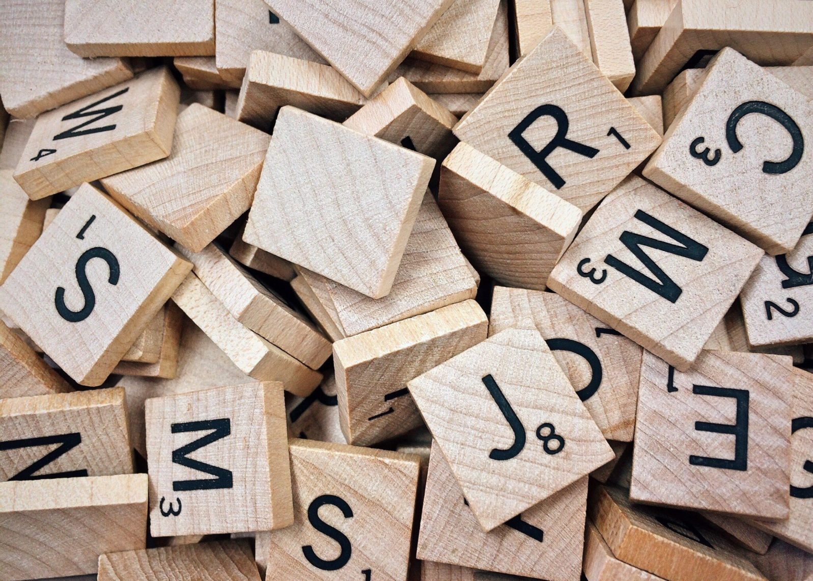Scrabble pieces with numbers and letters