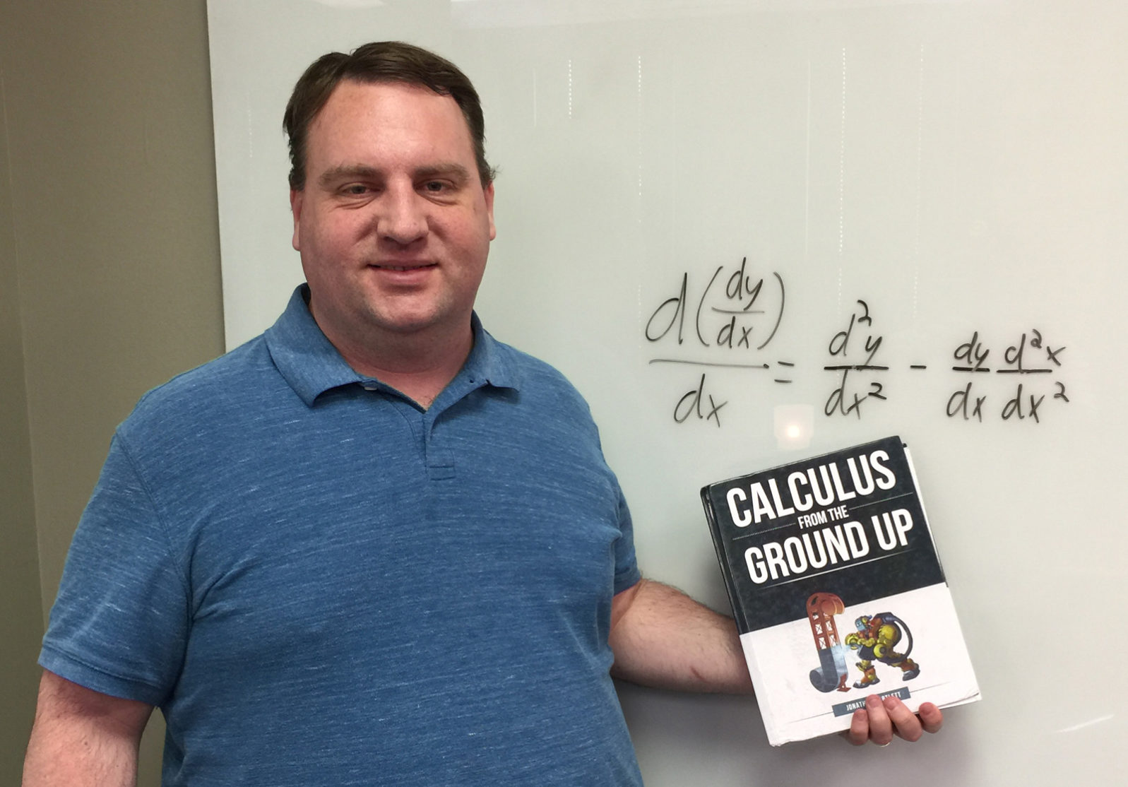 Jonathan Bartlett showing his textbook, Calculus from the Ground Up