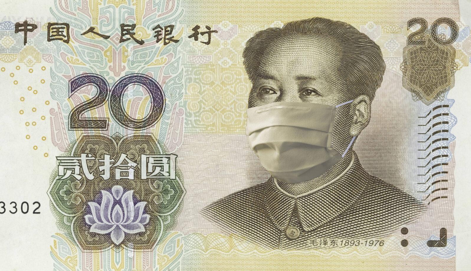 COVID-19 coronavirus in China, renminbi yuan money bill with face mask. COVID global stock market. World economy hit by corona virus outbreak. Financial crisis and coronavirus pandemic concept.