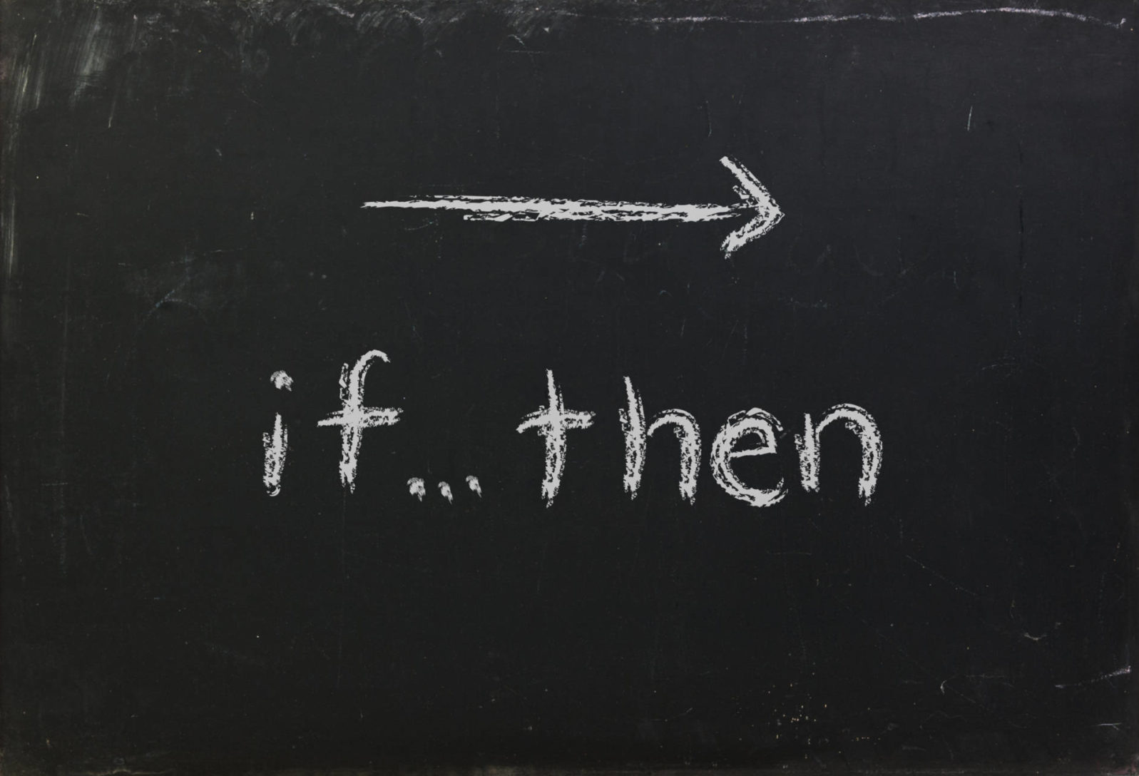 If Then logic statement written in white chalk on a black chalkboard isolated on white