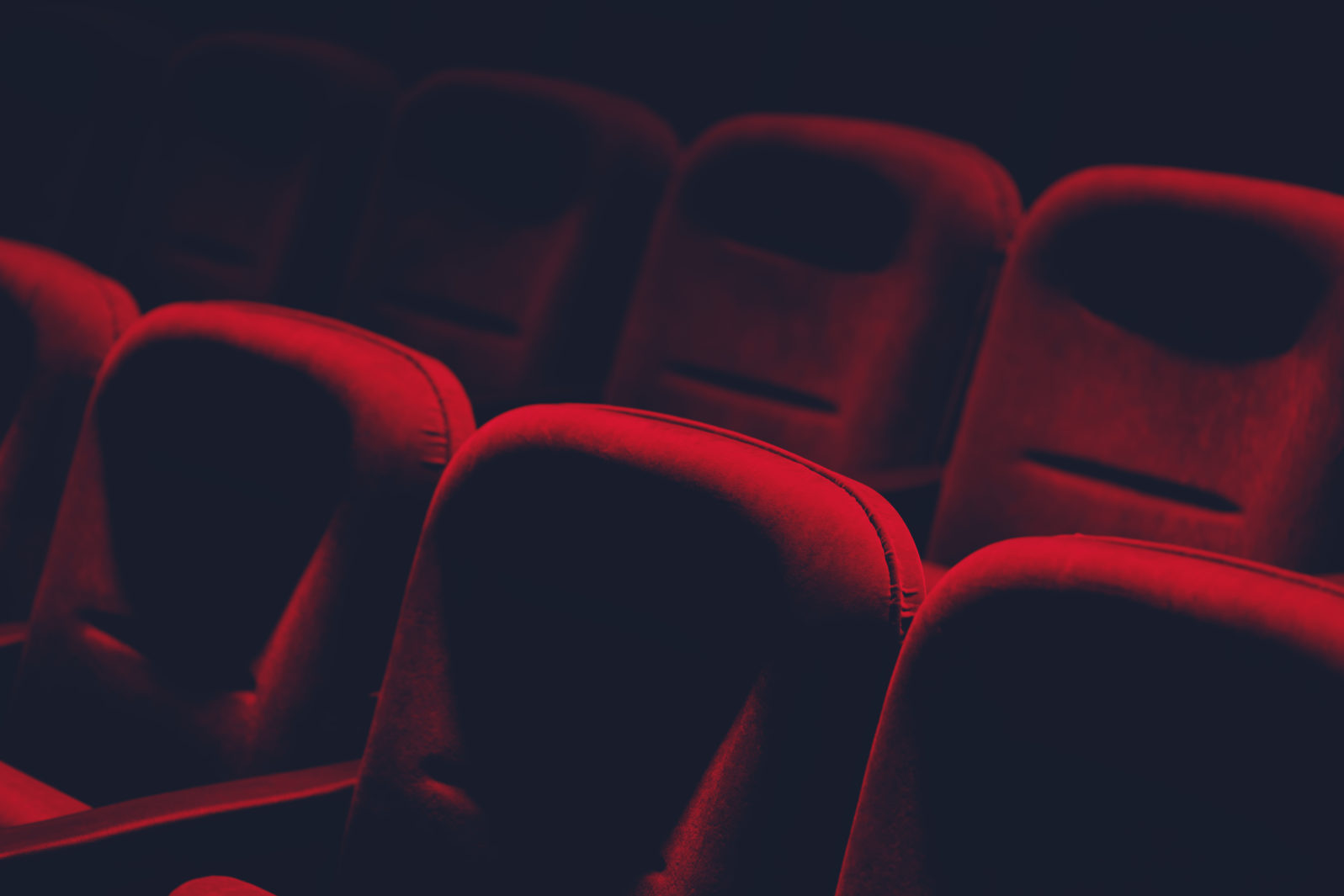 Empty cinema hall with red seats. Movie theatre