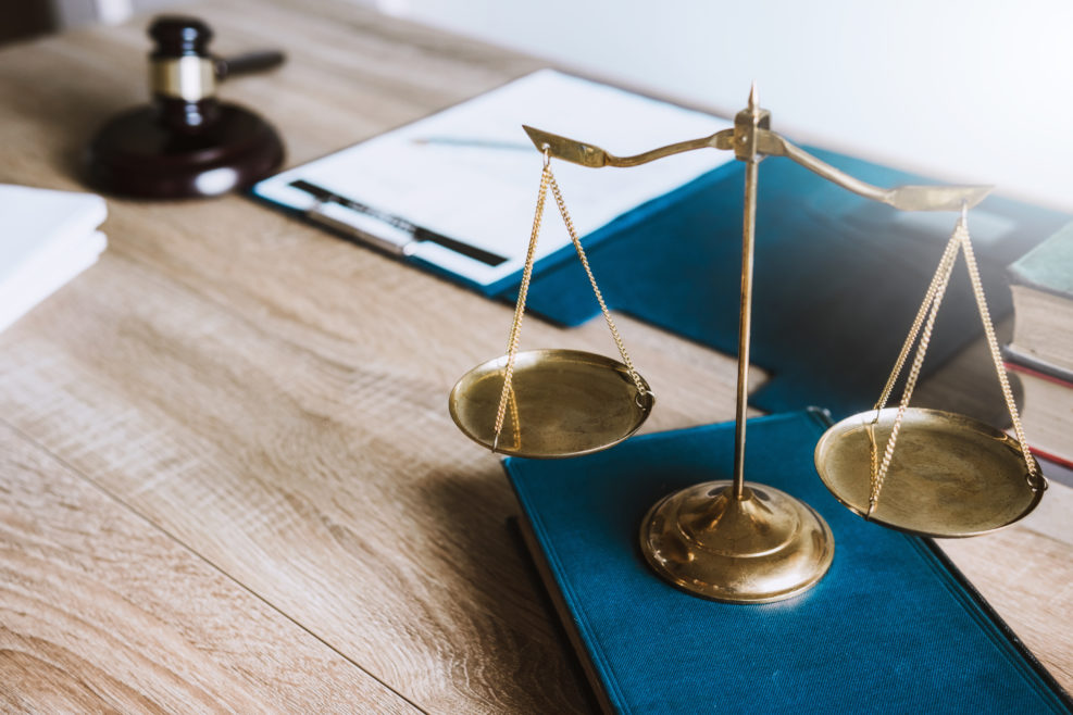 workplace of  lawyer business in office. wooden gavel , contact papers ,justice and law ,attorney, court judge,burden of proof.